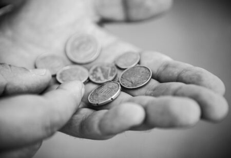 Euro Cent coins in the hands of hard worker photo