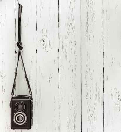 batten: Vintage medium format photo Camera on the wooden batten wall