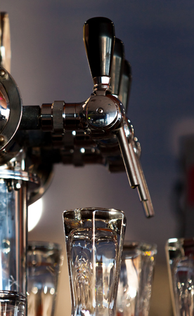 Beer tap in the morning light ready to work photo