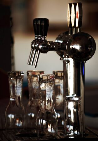 Beer tap and glasses ready to serve some pints Reklamní fotografie