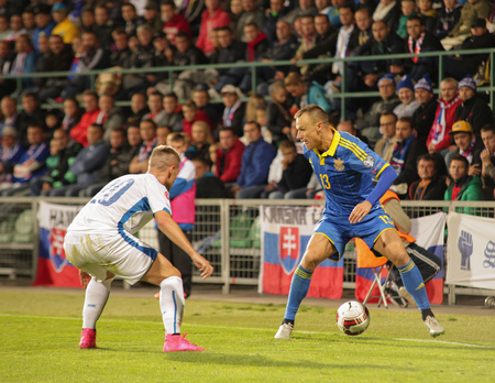 Zilina, Slovakia -  SEPTEMBER 8: Vyacheslav Shevchuk - ukrainian national soccer team player and Robert Mak during a UEFA EURO 2016   Slovakia - Ukraine match on September 8, 2015 in Zilina, Slovakia.