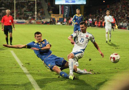 Zilina, Slovakia -  SEPTEMBER 8: Matus Kozacik and Artem Fedetskyi national soccer team players  during a UEFA EURO 2016   Slovakia - Ukraine match on September 8, 2015 in Zilina, Slovakia. Editorial