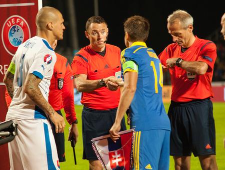 Zilina, Slovakia -  SEPTEMBER 8: Captains Ruslan Rotan, Martin Skrtel and Martin Atkinson welcome each other before UEFA EURO 2016   Slovakia - Ukraine match on September 8, 2015 in Zilina, Slovakia.
