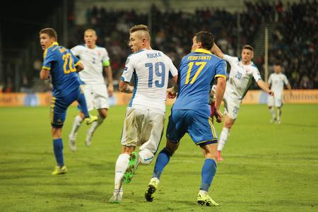 Zilina, Slovakia -  SEPTEMBER 8: Artem Fedetskyi and Juraj Kucka national soccer team player  during a UEFA EURO 2016   Slovakia - Ukraine match on September 8, 2015 in Zilina, Slovakia.
