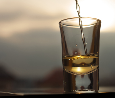 Whiskey pouring into shot glass