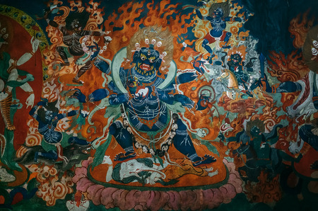 paint wall: Element of paint wall in Thiksey Monastery with Dharmapala idol Stock Photo