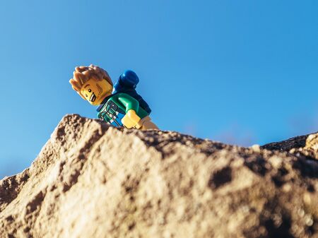 Zilina, Slovakia - December 30, 2016: Outdoor shot of Hiker LEGO minifigure on the top of mountain on December 30, 2016 in Zilina, Slovakia.