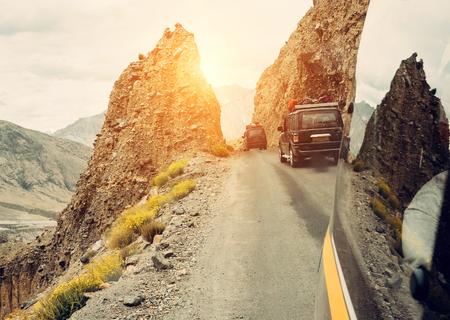 Trafic on mountain road Stock Photo