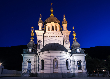 Orthodox Church of Christs Resurrection in Foros during sunrise time.