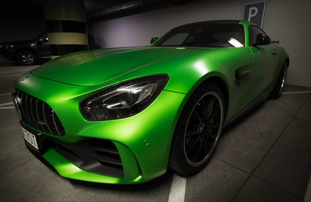 Zilina, Slovak Republik  Slovakia - November 09 , 2017: Native green colour Mercedes-AMG GT R Coupe standing at underground parking in Zilina, Slovakia