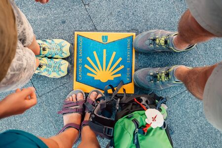 Bilbao, Spain - July 11, 2017: Three pairs piligrims feet on the start of the Camino de Santiago or Editorial