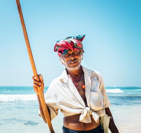 Local Sri Lanka lankian old fisherman portrait on the tropic sand coast beach Stock Photo