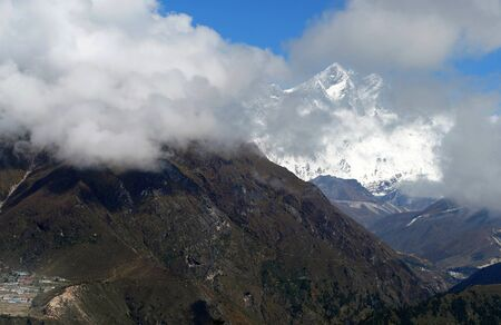 Lhotse  8516m mountain - is 4th higest peak in the world covered with clouds. Hotel Everest View point. Everest Base Camp trekking route near Namche Bazaar, Nepal.