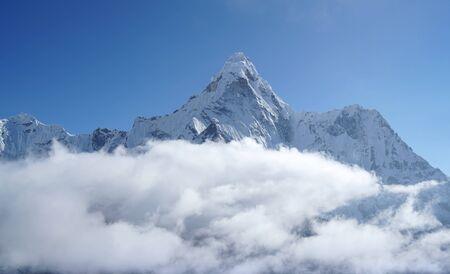Ama Dablam 6814m clouds covered peak View near Dingboche settlement in Sagarmatha National Park, Nepal. Everest Base Camp (EBC) trekking route. Stock Photo