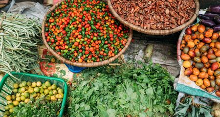 Street market still life top view image on the Kathmandu city, Nepal. Fresh vegetables and spices lying right on the path. Traditional Asian destinations traveling concept photo.