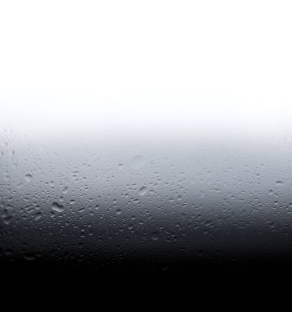Gradient from white to gray water drops pattern with unfocused blurred bokeh abstract texture.Visual art concept image. Stock Photo