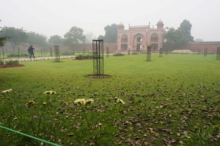 Tomb of Itimad-ud-Daulah main entrance in horizontal view, Agra, India, shot in the misty morning from the right side.