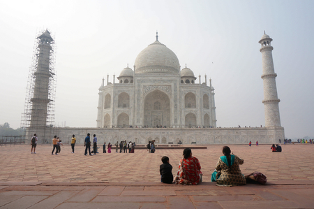 A son and mother with her friend enjoying a beautiful view of Taj Mahal, India, from the Southern Gate floor. Editorial