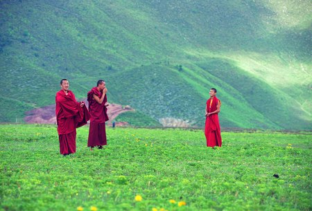 Tibetan monks on grasslands Editorial