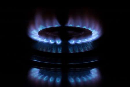 blue flame from gas range burner in dark background photo
