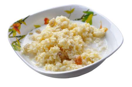 Homemade millet porridge with raisins isolated on white