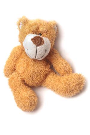 teddybear: Teddy bear sitting isolated on white background with shadow