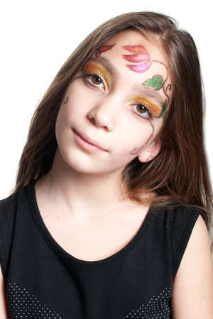 Young girl wearing black dress with painted face (floral colorful design) studio shot isolated on white background Stock Photo - 10311478