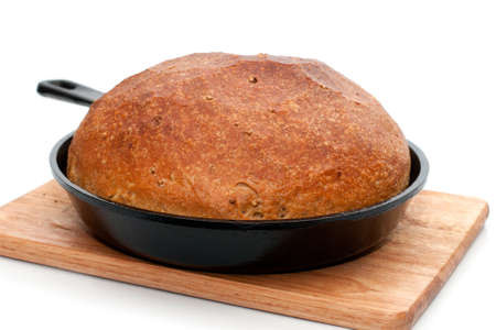 Homemade bread in frying pan isolated on white background with shadow