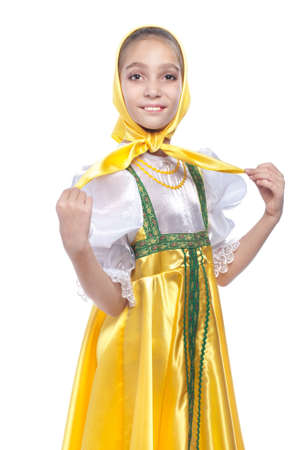 Girl wearing traditional russian dancing costume studio portrait isolated on white background Stock Photo