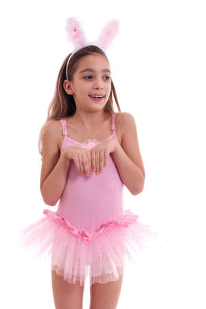 Half length studio portrait of a girl wearing ballerina outfit and rabbit ears looking away isolated on white background