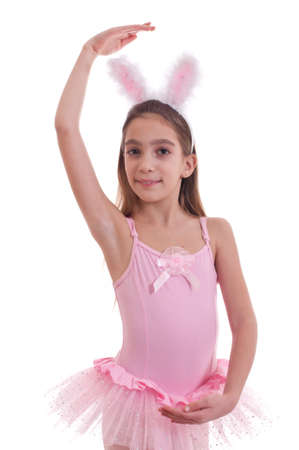 Half length studio portrait of a girl wearing ballerina outfit and rabbit ears looking at camera isolated on white background