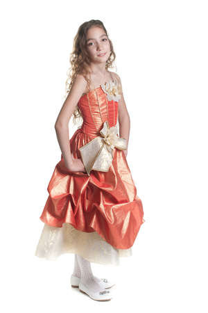 Beautiful smiling girl dressed like a princess looking at camera studio shot isolated on white background Stock Photo
