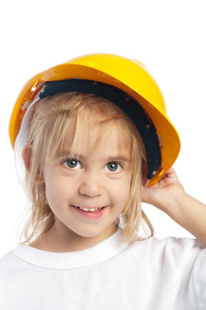 Little girl wearing yellow hard hat isolated on white background Stock Photo