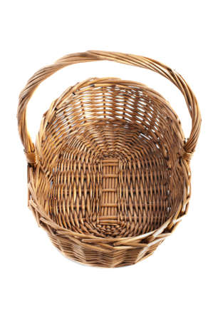 Empty wicker basket isolated on white background with shadow Stock Photo