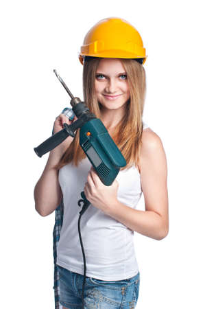 Girl holding a drill wearing yellow hard hat isolated on white background