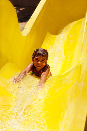 Happy child having fun in aquapark