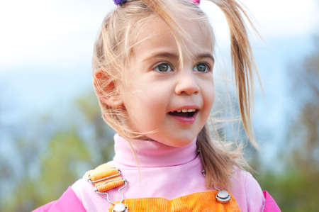 Happy amazed cute little girl spring outdoor portrait