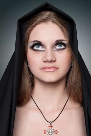 A portrait of the girl with beautiful big bright eyes in Gothic style photo