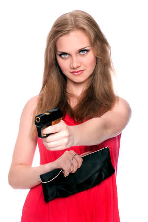 gangster girl: Beautiful girl aims a little gun at somebody isolated on white background
