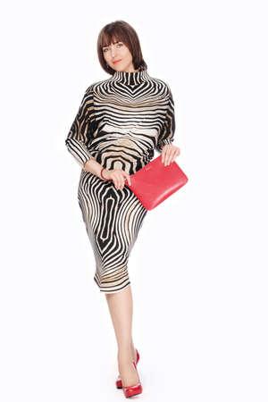 Beautiful fashionable woman in striped costume. Studio shot. Stock Photo