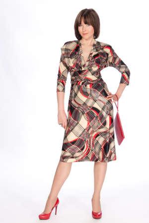 Beautiful fashionable woman in striking dress. Studio shot. Stock Photo