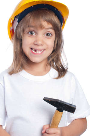 Funny little girl with hammer  wearing yellow hard hat isolated on white background