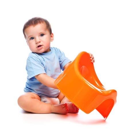 potty: Funny little boy playing with the orange potty studio portrait (isolated on white background) Stock Photo