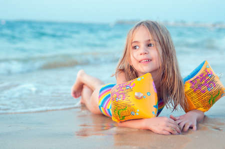 Sea vacation happiness Happy cute little girl on beach photo