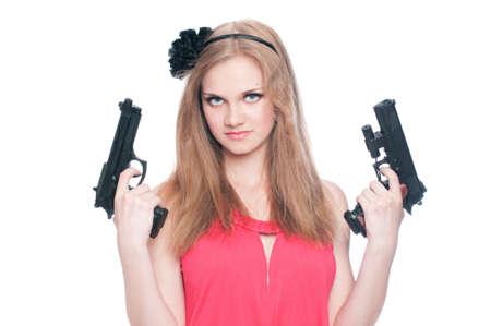 Beautiful girl holding two guns isolated on white background Stock Photo