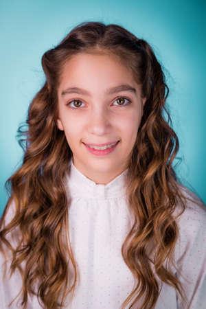 Happy smiling beautiful girl with braces on her teeth studio shot