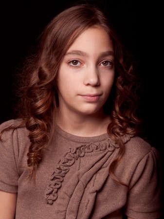 Beautiful teenager girl studio portrait  black background  photo