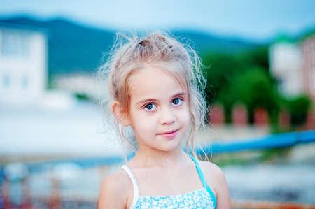 Happy cute little girl on beach Stock Photo