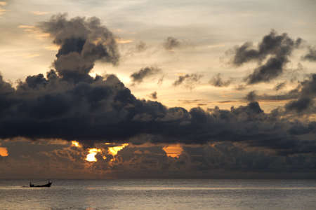 far off: Fishing boat with threatening clouds over South China Sea at Phu Quoc, Vietnam