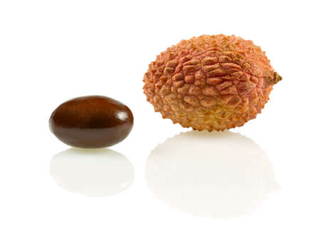 flavoursome: Isolated lychee (lat. Litchi chinensis) with pit Stock Photo